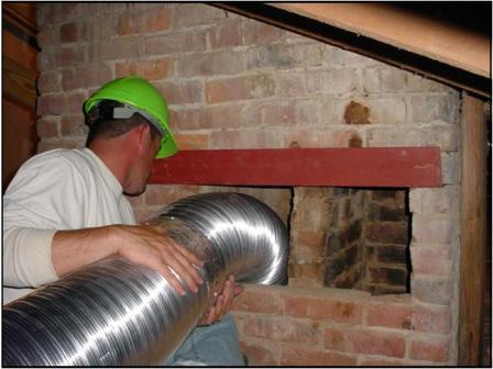 Directing ducts into chimney flues from the attic