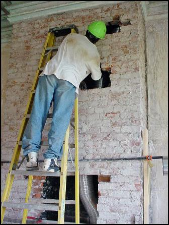 Guiding ductwork through a chimney breast