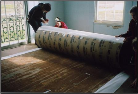 Carefully rolling floorcloth for transport
