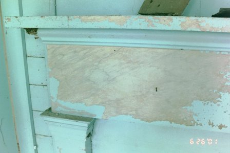 Manual removal of modern latex paint reveals original faux marble finish