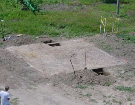 Archeological work on smokehouse foundation